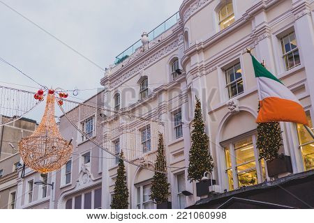 DUBLIN, IRELAND - January 6th, 2018: Grafton Street in Dublin city centre with festive Christmas decorations and Irish flag