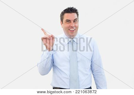 Closeup portrait of smiling middle-aged business man pointing finger aside. Advertisement concept. Isolated front view on white background.