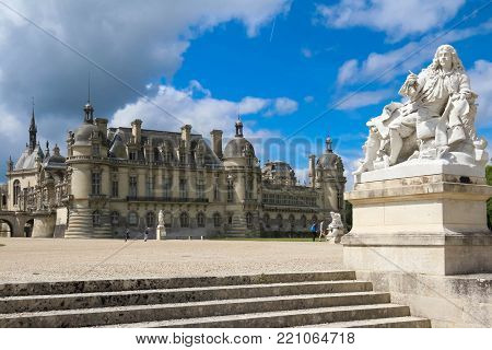 CHANTILLY, FRANCE , JUNE 04, 2017 : view of Chantilly castle of France on 04 JUNE 2017. It is a historic castle located in the town of Chantilly. It houses the Museum of Conde