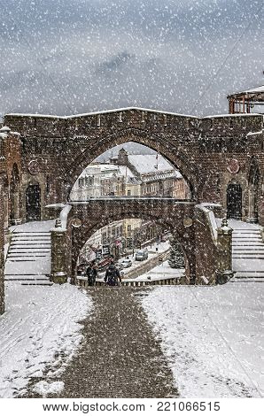An elevated view through an archway of the swedish city of Helsingborg during some wintry weather conditions.