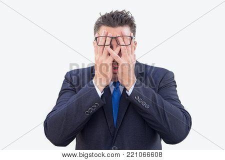 Frustrated businessman stressed out because of problems. Distraught male lawyer covering his face with hands while crying. Failure concept