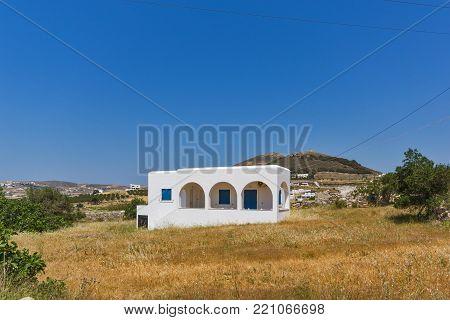 PAROS, GREECE - MAY 3, 2013: Rural landscape near town of Parikia, Paros island, Cyclades, Greece