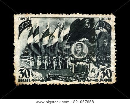 USSR - CIRCA 1946: canceled stamp printed in USSR shows All-Union Parade of Physical Culturists (sportsmans), circa 1946. Vintage post stamp isolated on black background.