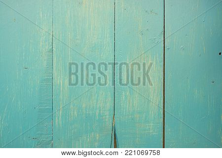 Pastel green stained wood background texture with horizontal parallel boards, woodgrain and copy space