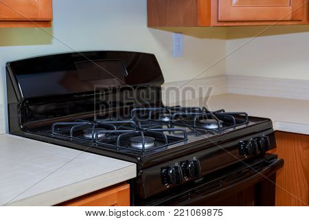 Close up image of the gas stove steal standing on kitchen gas stove.