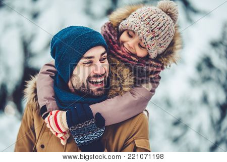 Dad With Daughter Outdoor In Winter