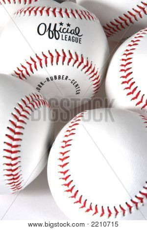 baseballs on white background close-up showing seams and official league poster