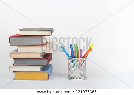 Book stacking. Open book, hardback books white background. Back to school. Copy space for text.