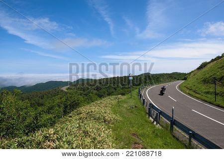 Scenic roads bending through the beautiful landscapes of Shiretoko National Park, Hokkaido, Japan