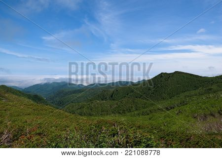 Panoramic views from the green Shiretoko Pass around Mount Rausu in Shiretoko National Park, Hokkaido, Japan