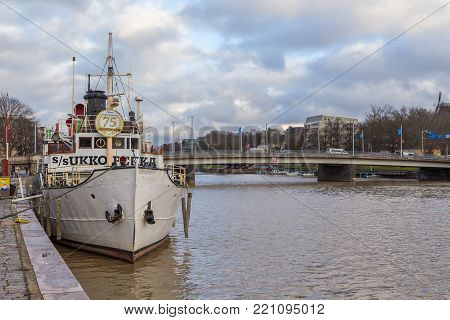 TURKU, FINLAND- November 01, 2013: Ship on the quay of the Aura river in Turku. Turku is the oldest city in Finland and first capital.