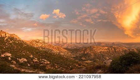 Sun setting behind mountains near to Lakeside and Blossom valley in the deserts of southern california