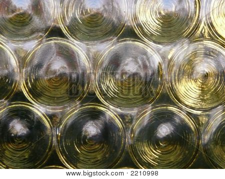 Yellow Glass With Circular Pattern