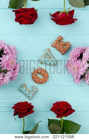 Valentines Day love cookies, top view. Flowers composition for Valentines Day. Celebration of anniversary with beloved.