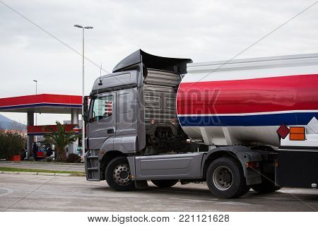 Gasoline truck on the background of a gas station