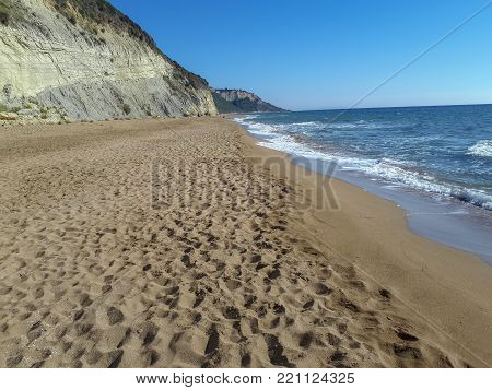 Lonely and peaceful Marathias beach in the south of the island of Corfu offers cliffs golden sand and turquoise waters Greece