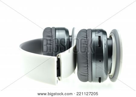 Wireless headphones with Mini USB  Adapter V4.0 isolated on a white background,  white headphone