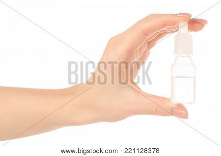 Drops for the nose of the ears of the eyes in the hand on a white background isolation