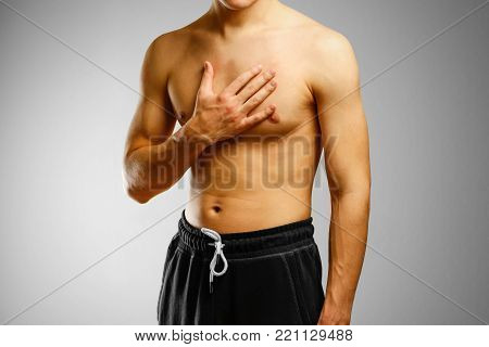 The guy with no shirt holding hand of patient's chest. The pain in his chest