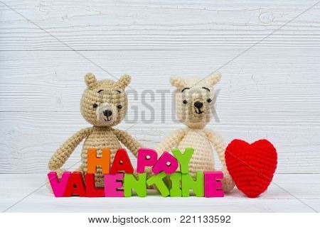 Sweet Couple Teddy Bear Doll In Love With Love Text And Red Knitting Heart On White Wooden Backgroun