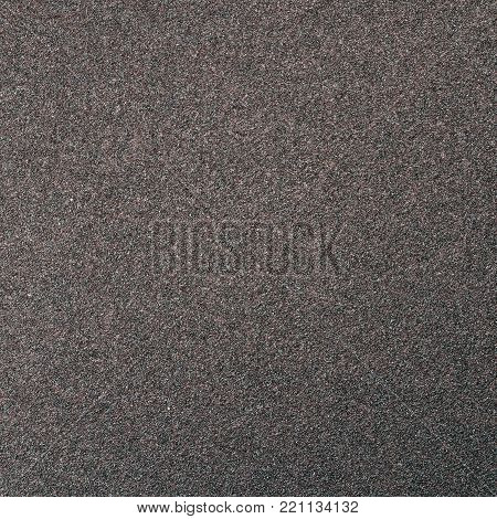Emery paper. Sandpaper texture. The abstract background.
