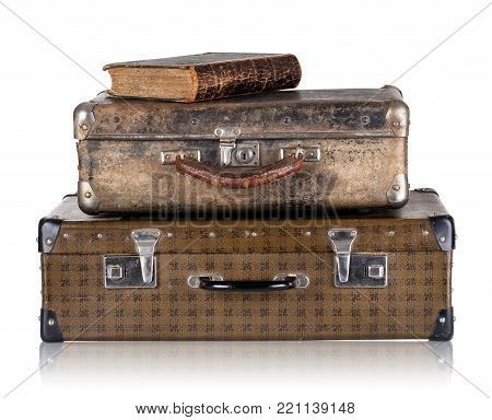 Vintage leather suitcases with book isolated on white background. The concept of time travel.