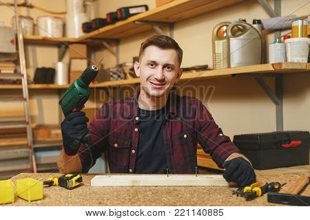 Caucasian Young Man In Plaid Shirt, Black T-shirt, Noise Insulated Headphones, Protective Mask Worki