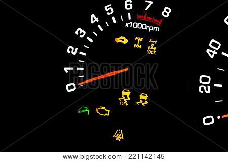 Car instrument panel, dashboard closeup with visible speedometer and fuel level. Modern steering wheel. Modern car interior details. odometer, tachometer