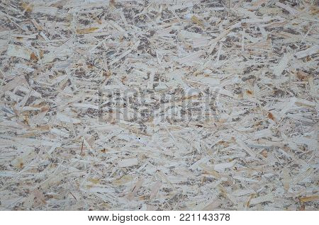 An Old Oriented Strand Board Osb , Fiberboard Background Of Texture. Sheet Is Made Of Brown Wood Chi