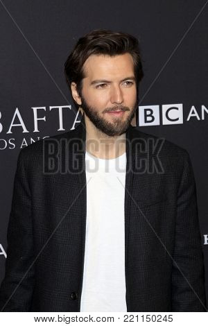 LOS ANGELES - JAN 6:  Guy Burnet at the 2018 BAFTA Tea Party Arrivals at the Four Seasons Hotel Los Angeles on January 6, 2018 in Beverly Hills, CA