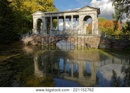 PUSHKIN, ST. PETERSBURG, RUSSIA – SEPTEMBER 20, 2015: Marble bridge in Catherine park. Also known as Siberian Marble Gallery, it was built in 1774 and modeled the Palladian Bridge from Wilton House