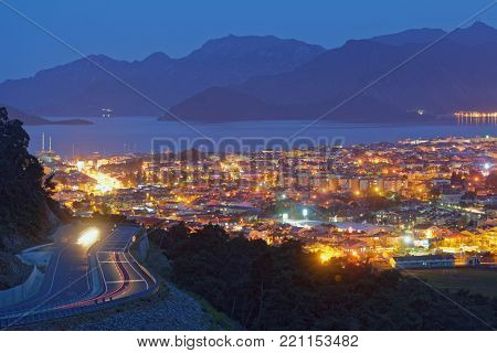 MARMARIS, TURKEY - APRIL 23, 2014: View to the bay and the night city. Marmaris population increases 10 times during the tourism season, and its nightlife rivals anything on the Turkish coast