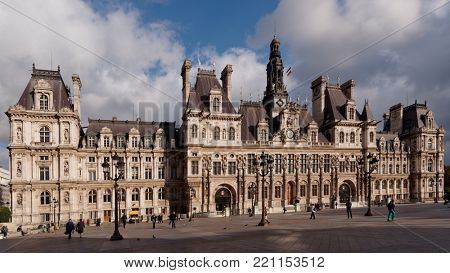 PARIS, FRANCE – SEPTEMBER 11, 2013: People on the Place de l'Hotel-de-Ville, formerly Place de Greve, against the City Hall building. The City of Paris's administration has been located on the same lo