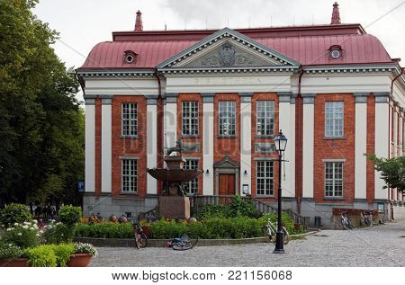 TURKU, FINLAND - AUGUST 19, 2017: Building of Turku City Library in a summer day. Built in 1903, with a recent and very modern integrated extension behind, equipped for the digital world