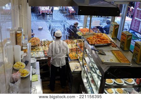ISTANBUL, TURKEY - MARCH 24, 2014: Cook waits for clients in the locanta Balkan. This net of Turkish restaurants is very popular among locals and tourists