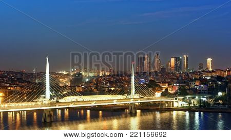 ISTANBUL, TURKEY – OCTOBER 13, 2017: Night view to Golden Horn metro bridge. This cable-stayed bridge across Golden Horn bay was completed in 2014