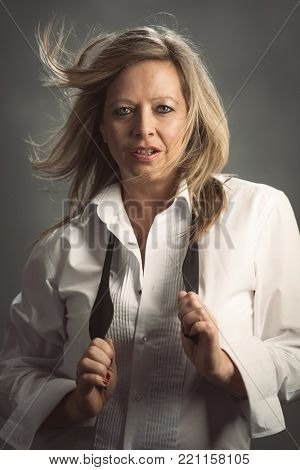 Mature woman wearing a white shirt and black bow tie