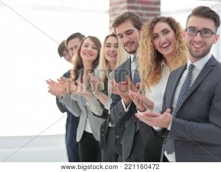 smiling business team applauding.