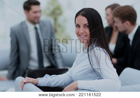 Portrait of businesswoman  looking at camera on the background o