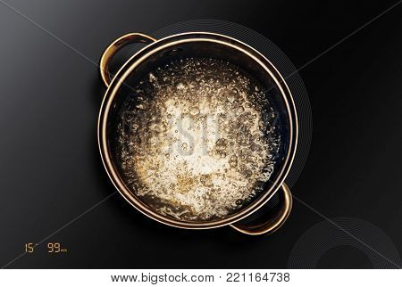 boiling water in saucepan that on an induction cooktop