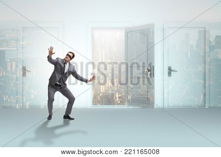 Confused businessman in front of doors
