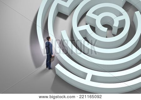 Businessman is trying to escape from maze labyrinth