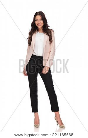 full body picture of a happy young business woman standing on white bakground