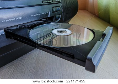 CD music and disc player on desk