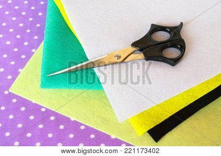 Set of sewing items. Sewing concept. Colored felt sheets set, scissors
