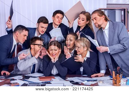 Mad business people office. Nervous breakdown boss. Team people are unhappy with their leader suffering stress, overworked employee. Intern woman manager does not cope with his duties.