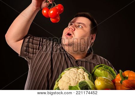 Diet fat man eating healthy food. Stop obesity concept. Health breakfast with vegetables . Male trying to lose weight and rejoices in healthy eating.