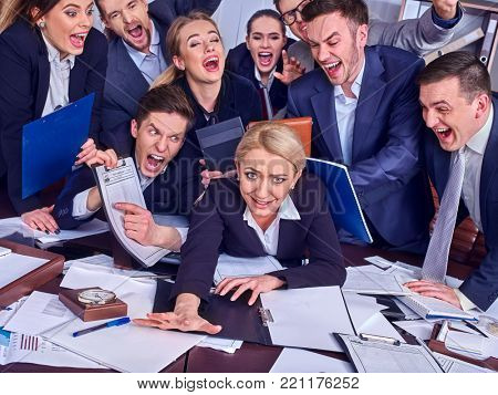 Mad business people office. Team people are unhappy with their leader. Intern woman manager does not cope with his duties. Change of boss in firm. Documents for signature.
