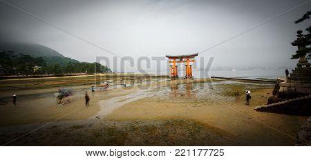 Low tide long exposure panorama in Miyajima with Floating Torii gate, Japan.