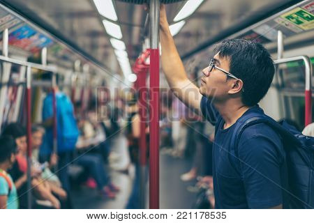 Young Man Traveler Is Visiting At Hongkong By Subway Mtr Train. The Mass Transit Railway Is The Rapi